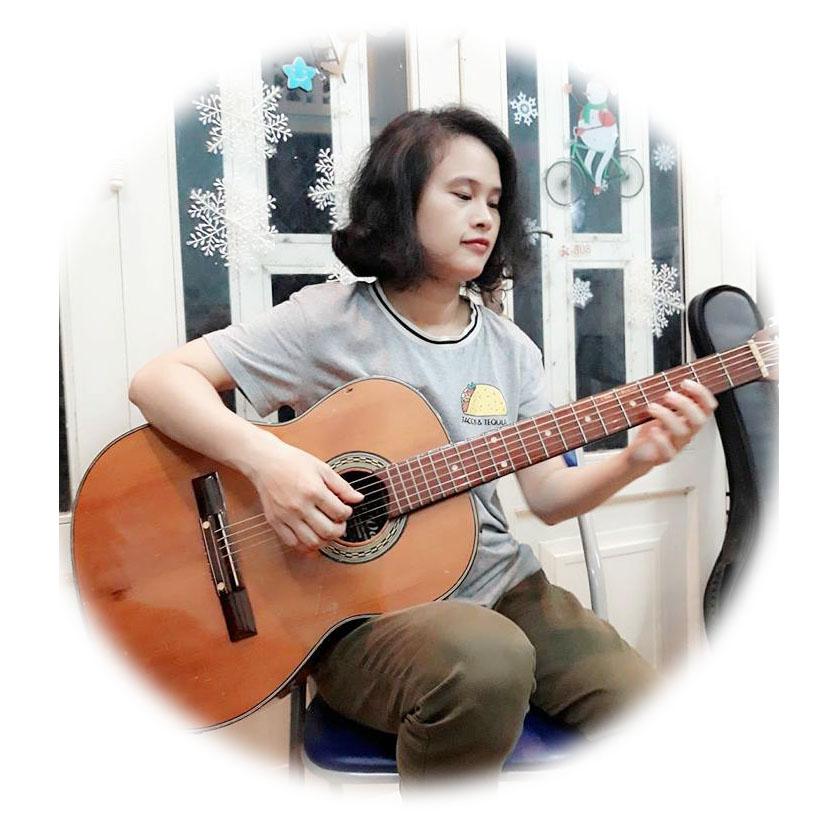 giao vien day guitar